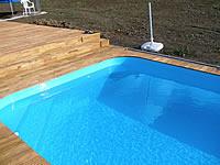 Terasa z akátu okolo bazénu natřena Pflege-Ol od fa. Remmers.Akátová terasová prkna