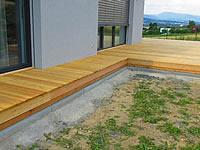 Dřevěná terasa ze sibiřského modřínu, po úpravě olejem pro modřín.